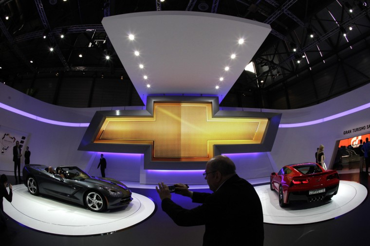 Visitors take pictures of Corvette cars on the Chevrolet booth during the second media day of the 83rd Geneva Car Show at the Palexpo Arena in Geneva. (Denis Balibouse/Reuters photo)