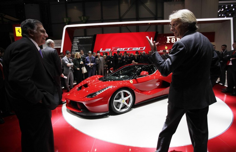 Ferrari CEO Luca Cordero di Montezemolo (R) talks to Tata Motors' Chairman Ratan Tata after the presentation of the new LaFerrari hybrid car on the Ferrari stand during the first media day of the 83rd Geneva Car Show. (Denis Balibouse/Reuters photo)