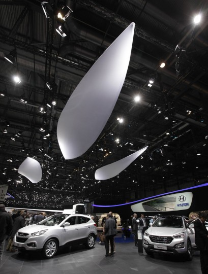 Visitors stroll through cars on the Hyundai booth during the second media day of the 83rd Geneva Car Show at the Palexpo Arena. (Denis Balibouse/Reuters photo)