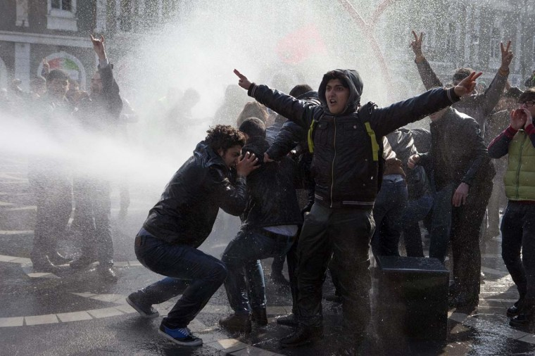 Policemen use water cannons to break up the crowd of protesters during a rally in Baku, March 10, 2013. Police in Azerbaijan fired rubber bullets and water cannon at hundreds of opposition protesters demonstrating on Sunday against violence in the military in the oil-rich country. (Elmar Mustafazadeh/Reuters)