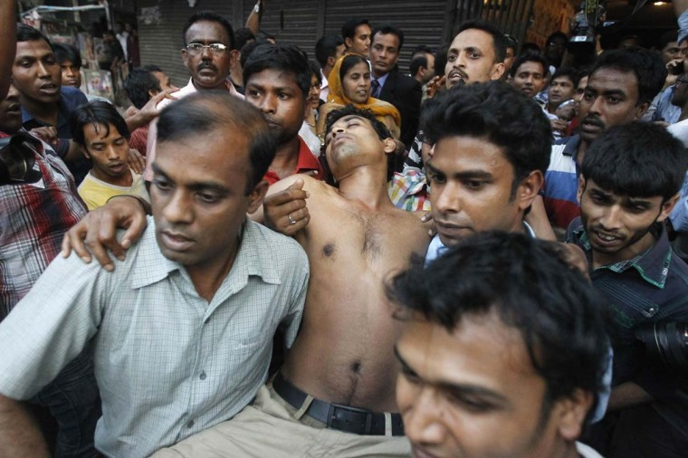 Activists of Bangladesh Nationalist Party (BNP) carry a comrade after he was injured by rubber bullets during a clash in front of the party office in Dhaka March 6, 2013. Hundreds of activists were injured as police opened fire and charge tear gas during a demonstration by main opposition BNP and it's allies Bangladesh Jamaat-e-Islami in protest against what it said were violence and killings by the police over war tribunals, local media reported. (Andrew Biraj/Reuters)