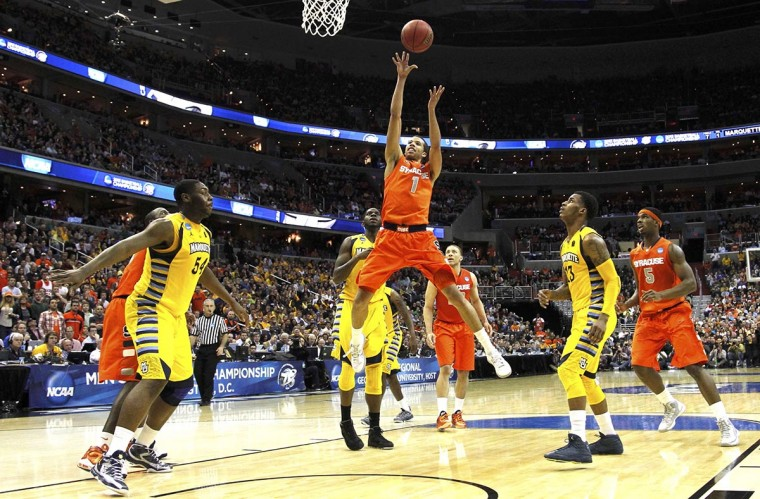 Syracuse Orange guard Michael Carter-Williams shoots against the Marquette Golden Eagles during the second half in their East Regional NCAA men's basketball game in Washington, March 30, 2013. (Jason Reed/Reuters)