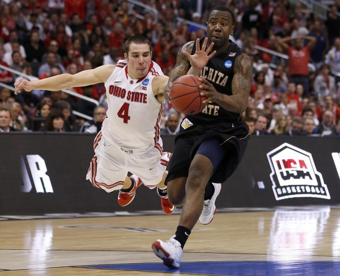 Ohio State Buckeyes guard Aaron Craft (4) dives to try and stop Wichita State Shockers guard Malcolm Armstead (2) from scoring in the second half during their West Regional NCAA men's basketball game in Los Angeles, California March 30, 2013. (Danny Moloshok /Reuters)