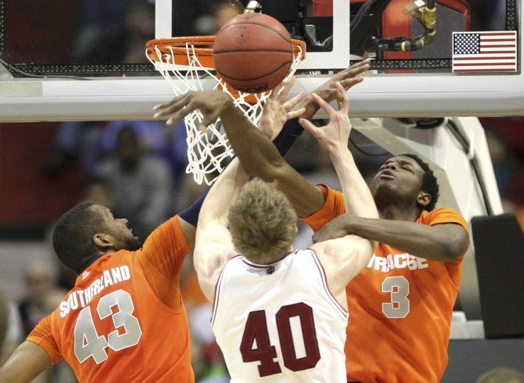 Indiana Hoosiers forward Cody Zeller is double teamed by Syracuse forwards James Southerland (L) and Jerami Grant during their East Regional NCAA men's basketball game in Washington, March 28, 2013. (Jonathan Ernst/Reuters)