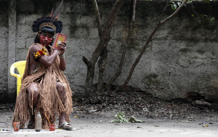 A native indian paints his face at the Brazilian Indian Museum in Rio de Janeiro. A native Indian community of around 30 individuals who have been living in the abandoned Indian Museum since 2006, were summoned to leave the museum in 72 hours by court officials since last Friday, local media reported. The group is fighting against the destruction of the museum, which is next to the Maracana Stadium. (Sergio Moraes/Reuters photo)