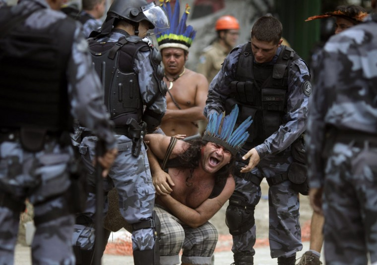A native Indian reacts as military police officers evict a native Indian community living at the Brazilian Indian Museum in Rio de Janeiro. The community was ordered to leave the museum in 72 hours by court officials since last week, local media reported. Most of the Indians later left the museum after making a deal with the authorities. (Ricardo Moraes/Reuters)