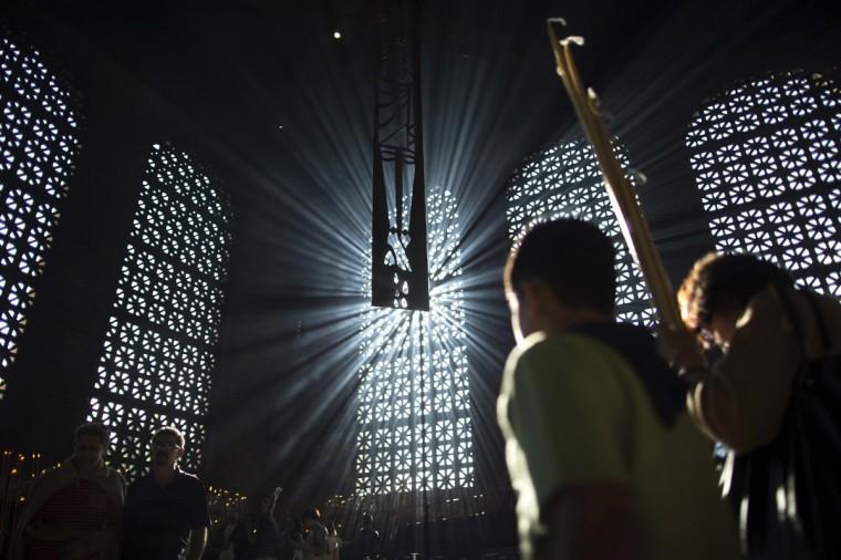 Catholic worshippers celebrate Good Friday inside the Our Lady of Aparecida Basilica in Aparecida do Norte, Sao Paulo, Brazil. (Roosevelt Cassio/Reuters)