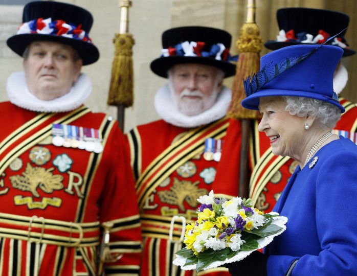 Britain's Queen Elizabeth walks past Yeomen of the Guard as she leaves the Maundy Service at Christ Church Cathedral in Oxford, southern England. (Kirsty Wigglesworth/Reuters photo)