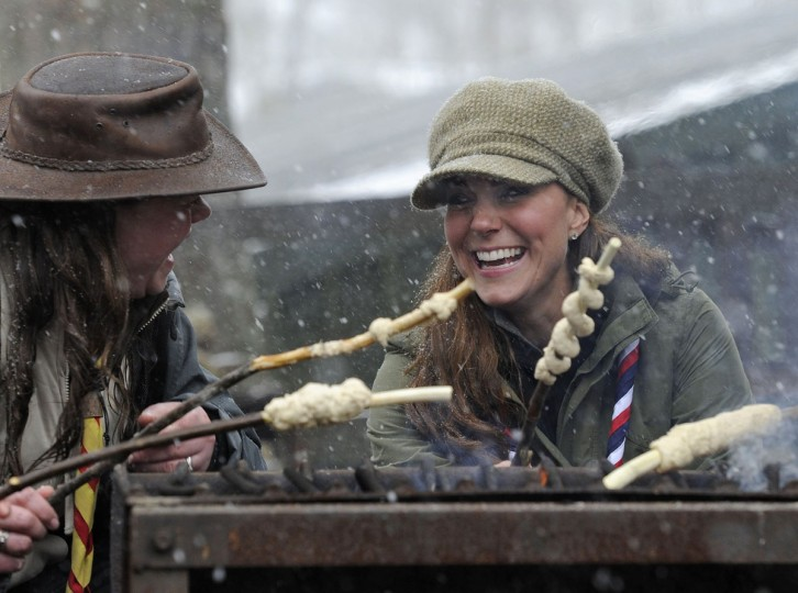 Britain's Catherine, Duchess of Cambridge cooks bread twists during her visit to the Great Tower Scout Camp at Newby Bridge in Cumbria, northern England. (Andy Stenning/pool/Reuters)