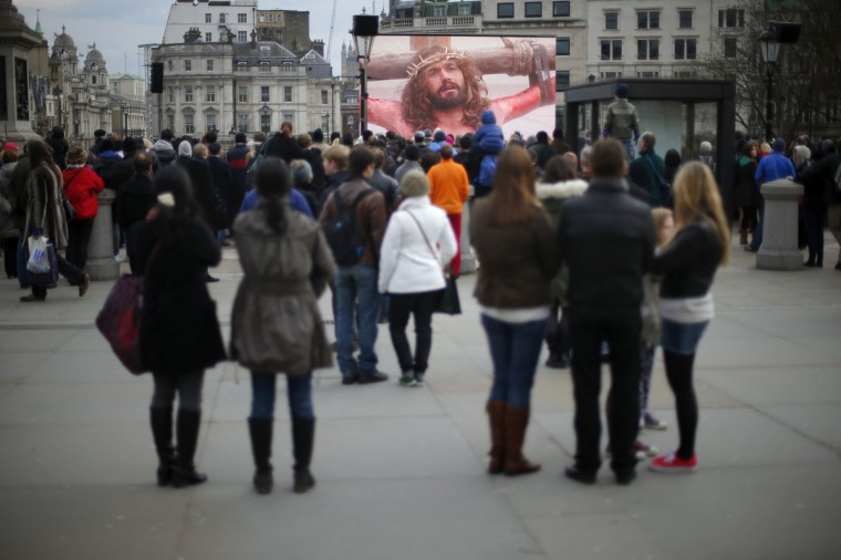 """March 29, 2013: Audience members watch a performance of the """"Passion of Christ"""" in Trafalgar Square, London. (Andrew Winning/Reuters)"""