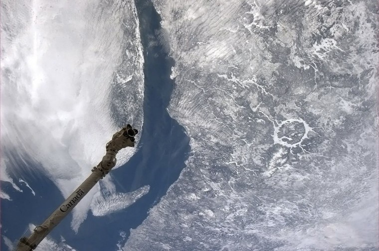 The iconic Manicouagan meteor crater in Quebec is pictured in this handout photo taken March 14, 2013, courtesy of the Canadian Space Agency. The crater is one of the oldest known impact craters on Earth, still visible from space and is located primarily in Manicouagan Regional County Municipality in the CÙte-Nord region of Quebec. (CSA/Chris Hadfield/Handout/Reuters)