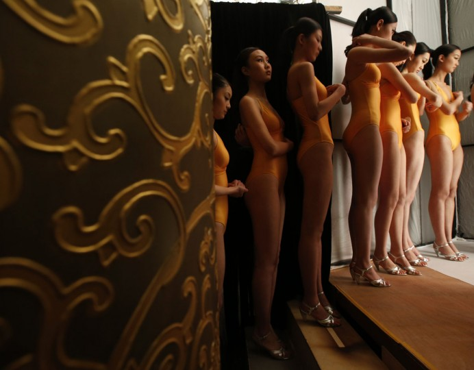 Contestants wait backstage for the start of the China Super Model Final during China Fashion Week in Beijing. (Kim Kyung-Hoon/Reuters)