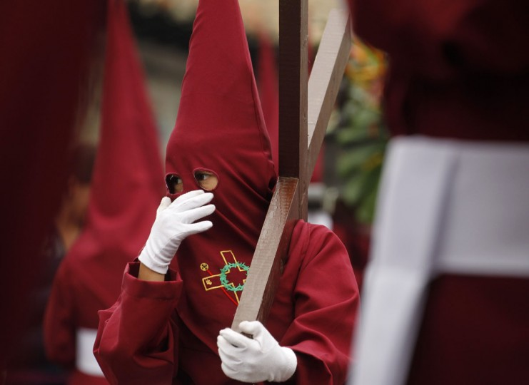 March 29, 2013: A member of the Nazarenos brotherhood take part in a Holy Week procession in Zipaquira, Colombia. (John Vizcaino /Reuters)