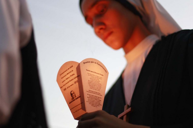A nun holds a candle as she takes part in a march ahead of the 33rd anniversary of assassination of the late Archbishop Oscar Arnulfo Romero in San Salvador March 16, 2013. Romero was murdered by a right-wing hit squad while preparing for mass at the Divina Providencia Cancer Hospital in San Salvador on March 24, 1980. (Ulises Rodriguez/Reuters)