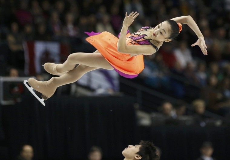 Sui Wenjing (top) and Han Cong of China perform in the pairs short program at the ISU World Figure Skating Championships in London. (Mark Blinch/Reuters)