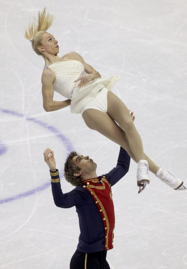 Stacey Kemp (Top) and David King of Great Britain perform their free skating program at the ISU World Figure Skating Championships in London. (Fred Thornhill/Reuters)