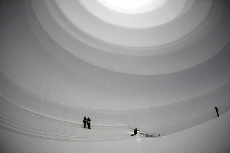 Journalists stand inside the latest work of art 'Big Air Package' by artist Christo, during a preview at the Gasometer in Oberhausen. The indoor installation 'Big Air Package' which was created for the former gas holder, is 90 metres high, with a diameter of 50 metres and a volume of 177,000 cubic metres. (Ina Fassbender/Reuters)
