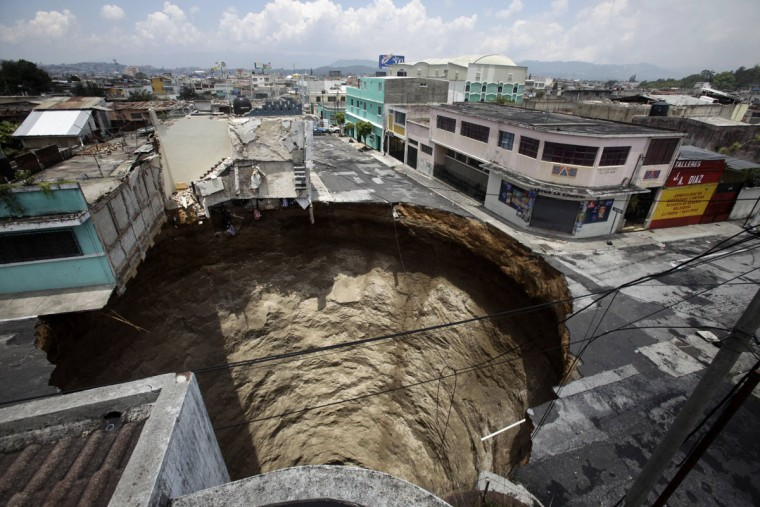 A giant sinkhole caused by the rains of tropical storm Agatha is seen in Guatemala City on June 1, 2010. Collapsed roads and highway bridges complicated rescue efforts after Agatha drenched Central America, burying homes under mud and killing at least 175 people. (Daniel LeClair/Reuters)