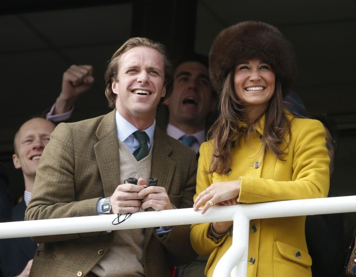 Pippa Middleton (R), the sister of Catherine, the Duchess of Cambridge, reacts while watching the first race with an unidentified companion at the Cheltenham Festival horse racing meet in Gloucestershire, western England March 14, 2013. (Eddie Keogh/Reuters photo)