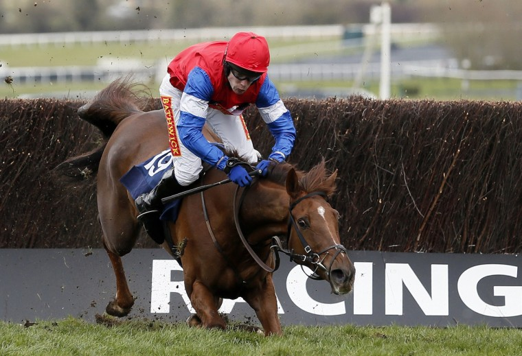 Poole Master falls, unseating jockey Tom Scudamore during the Specialty Handicap Steeple Chase at the Cheltenham Festival horse racing meet in Gloucestershire, western England. (Stefan Wermuth/Reuters)