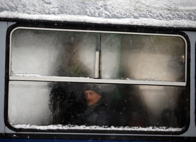 A man looks out of the window of a public transport bus in Budapest. An unusual spell of cold has engulfed Hungary over the recent days, causing widespread snowfall and some disruptions in traffic. (Laszlo Balogh/Reuters)