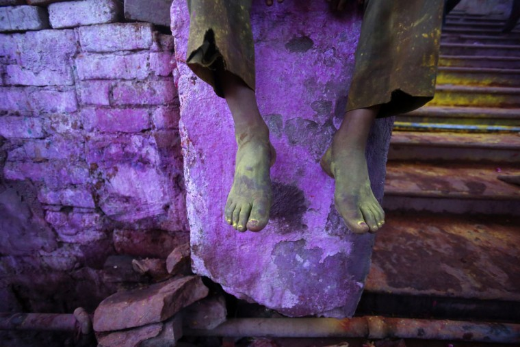 The colourd feet of a Hindu devotee are pictured outside a temple during Lathmar Holi at the village of Barsana in the northern Indian state of Uttar Pradesh. (Vivek Prakash/Reuters)