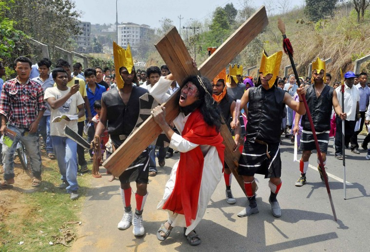 March 29, 2013: A man playing the role of Jesus carries a cross during a Good Friday procession in the northeastern Indian city of Guwahati. (Utpal Baruah/Reuters)