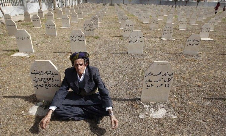 An Iraqi Kurd resident visits the cemetery for victims of the 1988 chemical attack in the Kurdish town of Halabja, near Sulaimaniya, 160 miles northeast of Baghdad, March 16, 2013. Iraqi Kurds on Saturday marked the 25th anniversary of the chemical attack on the northern Iraqi city of Halabja by Saddam Hussein's forces. Up to 5,000 people may have been killed by chemical gas, villages were razed and thousands of Kurds were forced into camps during the 1988 Anfal genocidal campaign against Iraqi Kurds. (Thaier al-Sudani/Reuters)