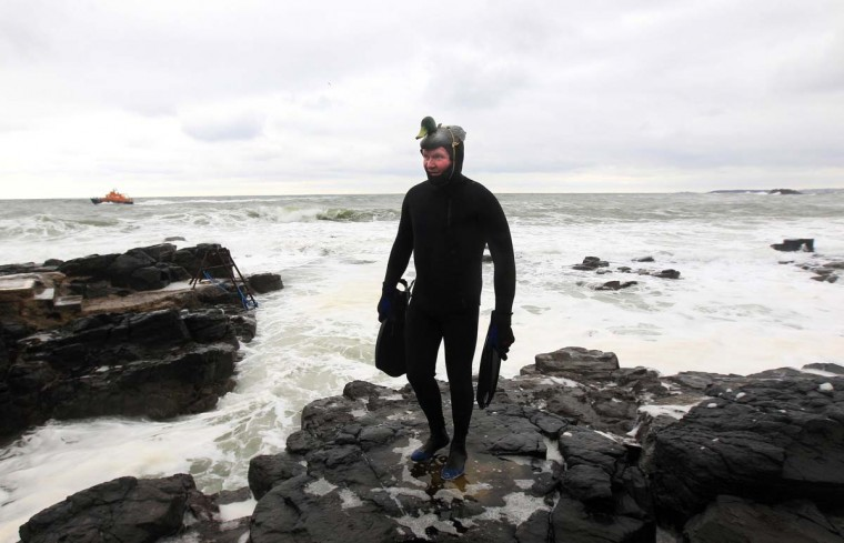 A man in fancy dress takes part in a charity event to celebrate Saint Patrick's Day and raise money for local charities in the town of Portstewart, County Londonderry March 17, 2013. (Cathal McNaughton/Reuters)
