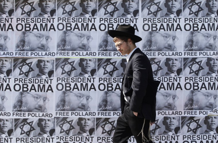 An ultra-Orthodox Jewish man walks past posters calling for U.S. President Barack Obama to free Jonathan Pollard from a U.S. prison, in Jerusalem March 20, 2013. Obama arrives in Israel on Wednesday without any new peace initiative to offer disillusioned Palestinians and facing deep Israeli doubts over his pledge to prevent a nuclear-armed Iran. Pollard, a former U.S. Navy intelligence analyst, has been serving a life sentence in the United States since he was caught spying for Israel in the 1980s. (Baz Ratner/Reuters photo)