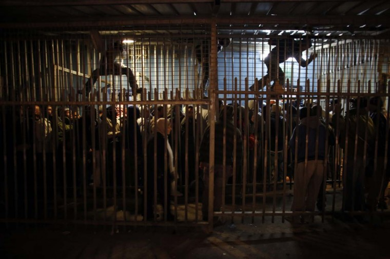 Palestinian labourers wait to cross into Jerusalem at an Israeli checkpoint in the West Bank town of Bethlehem March 18, 2013. U.S. President Barack Obama is due to make his first official visit to Israel and the Palestinian Territories this week, looking to improve ties after sometimes rocky relations with both sides during his first term in office. Israeli settlement expansion lies at the heart of much of the rancour between Israeli Prime Minister Benjamin Netanyahu and Obama, who has said the U.S. does not accept the legitimacy of continued settlement. (Ammar Awad/Reuters)