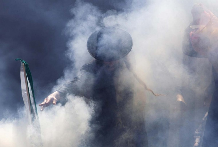 An Ultra-Orthodox Jewish man is seen through the smoke as they burn leaven in the Mea Shearim neighborhood of Jerusalem, ahead of the Jewish holiday of Passover, March 25, 2013. Passover commemorates the flight of Jews from ancient Egypt, as described in the Exodus chapter of the Bible. According to the account, the Jews did not have time to prepare leavened bread before fleeing to the promised land. (Ronen Zvulun/Reuters)