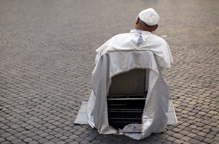 Plisko Julius, a 54-year-old from Slovakia, performs on a street as the late Pope John Paul II at Piazza Navona in Rome March 3, 2013. (Alessandro Bianchi/Reuters)