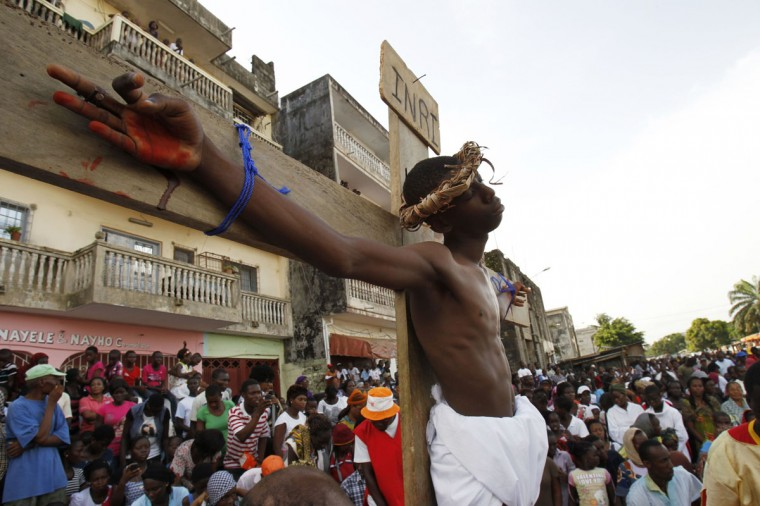 """March 29, 2013: An actor portraying Jesus Christ takes part in a """"Via Crucis"""" (Way of the Cross) procession during Holy Week at Plateau Dokui, an area of Abidjan, Ivory Coast. (Luc Gnago/Reuters)"""