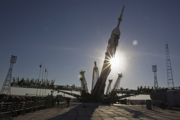 The Soyuz TMA-08M spacecraft is lifted to its launch pad at the Baikonur cosmodrome. The Soyuz will carry U.S. astronaut Chris Cassidy along with Russian cosmonauts Pavel Vinogradov and Alexander Misurkin to the International Space Station on March 29. (Shamil Zhumatov/Reuters)