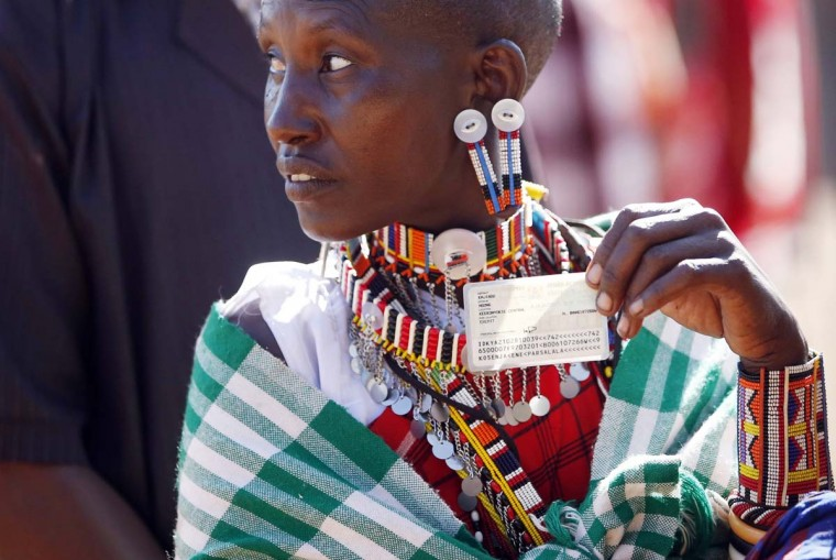 A Masai woman holds her ID card as she waits to cast her ballot in a polling station during the presidential and parliamentary elections near town of Magadi some 53 miles south of Nairobi. (Goran Tomasevic/Reuters)
