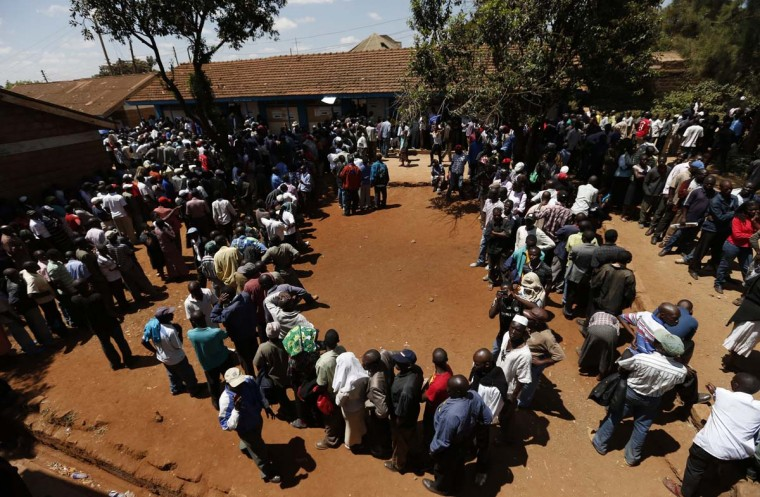 Kenyans wait in line to cast their vote in the Kibera slum in the capital Nairobi March 4, 2013. (Steve Crisp/Reuters)
