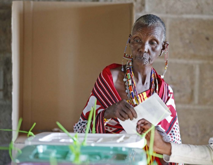 A Masai woman casts her ballot in a polling station during the presidential and parliamentary elections near town of Magadi some 53 miles south of Nairobi March 4, 2013. (Goran Tomasevic/Reuters)