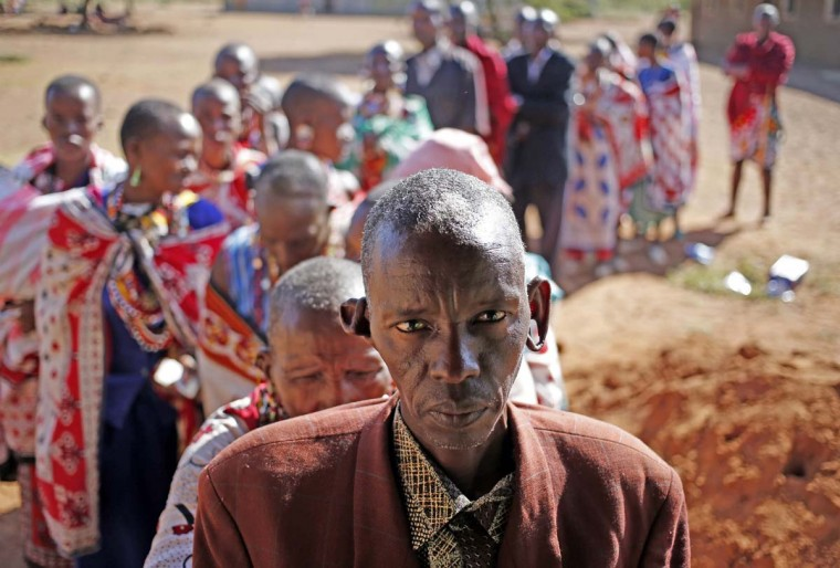 Masai wait to cast ballot papers outside a polling station during the presidential and parliamentary elections near town of Magadi some 53 miles south of Nairobi March 4, 2013. (Goran Tomasevic/Reuters)