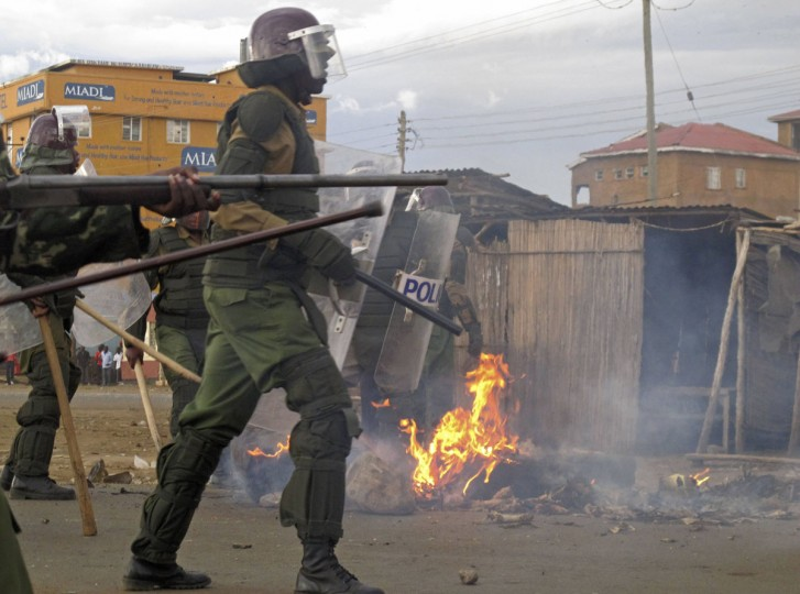 Riot police walk past a bonfire lit by supporters of Kenya's Prime Minister Raila Odinga, the defeated presidential candidate of the Coalition for Reforms and Democracy (CORD), after the Supreme Court ruling in the western town of Kisumu, March 30, 2013. Kenyan police fired teargas on Saturday at hundreds of stone-throwing youths in the western city of Kisumu, a stronghold of Odinga, after a court threw out his challenge to the victory of rival Uhuru Kenyatta. (Moses Eshiwani/Reuters)