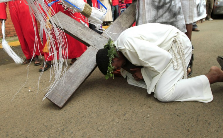 March 29, 2013: A man playing the role of Jesus falls while carrying a cross during a re-enactment of the Stations of the Cross at the Holy Family minor Basilica in Kenya's capital Nairobi. (Thomas Mukoya/Reuters)