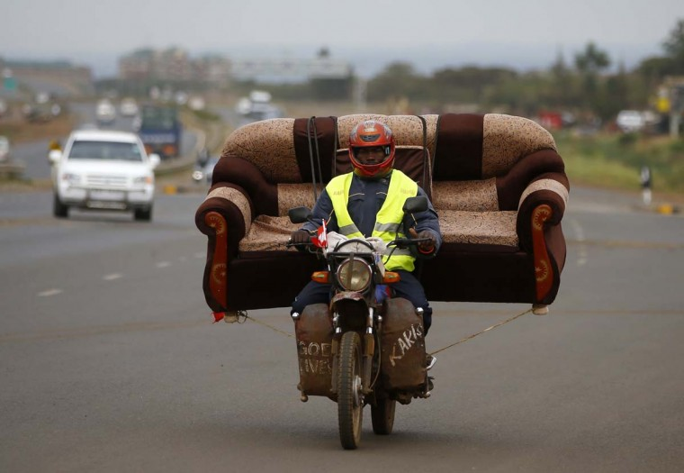 A man carries a sofa on his motorcycle on a highway near Kenya's capital Nairobi March 10, 2013. (Marko Djurica/Reuters)