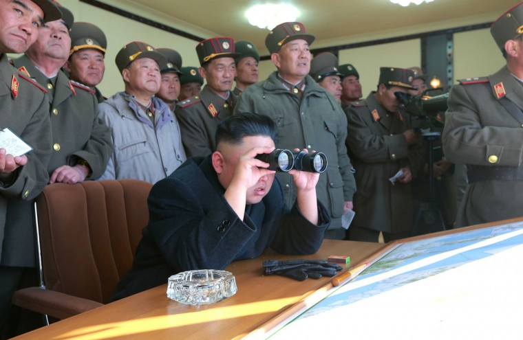 North Korean leader Kim Jong-un (C) and military officers watch a live shell firing drill to examine war fighting capabilities of artillery sub-units, whose mission is to strike DaeYeonpyeong island and Baengnyeong island of South Korea, in the western sector of the front line in this picture released by the North's official KCNA news agency in Pyongyang. (KCNA/via Reuters)