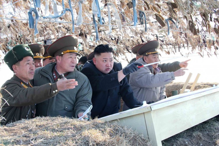 North Korean leader Kim Jong-Un (C) visits the Wolnae Islet Defence Detachment in the western sector of the front line, which is near Baengnyeong Island of South Korea. (KCNA via Reuters)