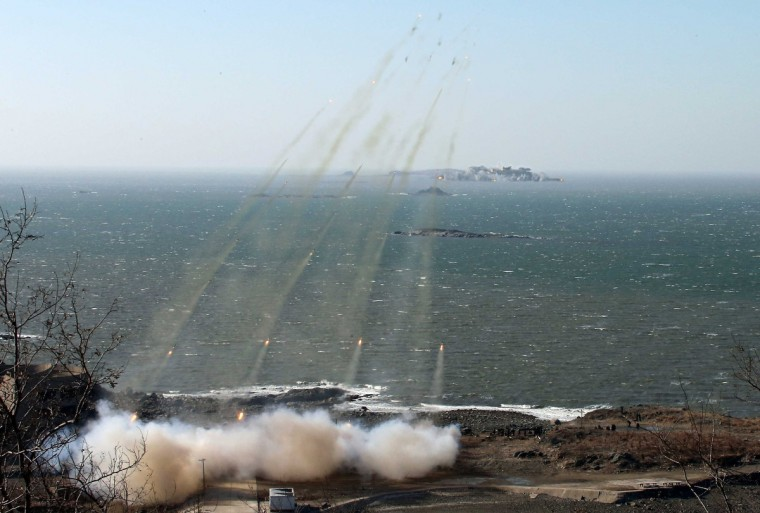 North Korea's artillery sub-units, whose mission is to strike Daeyeonpyeong island and Baengnyeong island of South Korea, conduct a live shell firing drill to examine war fighting capabilities in the western sector of the front line in this picture released by the North's official KCNA news agency in Pyongyang. (KCNA/via Reuters)