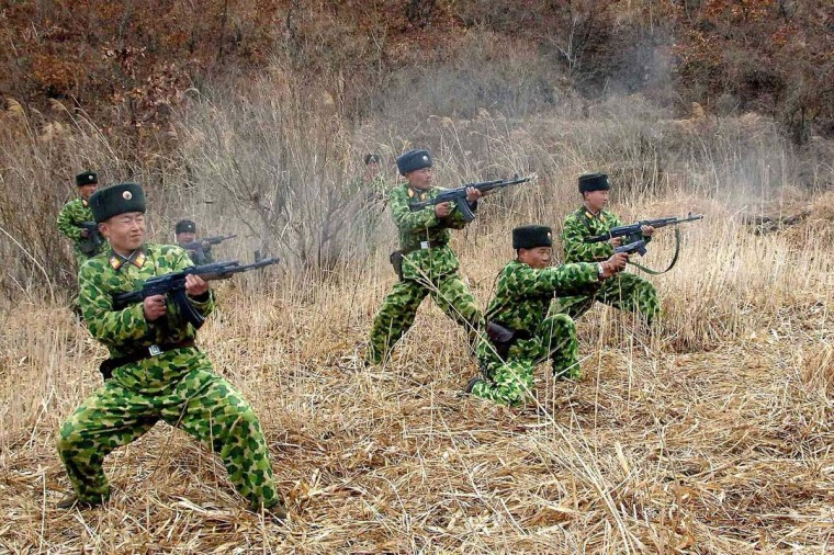 North Korean soldiers with weapons attend military training in an undisclosed location in this picture released by the North's official KCNA news agency in Pyongyang March 11, 2013. South Korea and U.S. forces are conducting large-scale military drills until the end of April, while the North is also gearing up for a massive state-wide military exercise. North Korea has accused the U.S. of using the military drills in South Korea as a launch pad for a nuclear war and has threatened to scrap the armistice with Washington that ended the 1950-53 Korean War. (KCNA/Reuters)