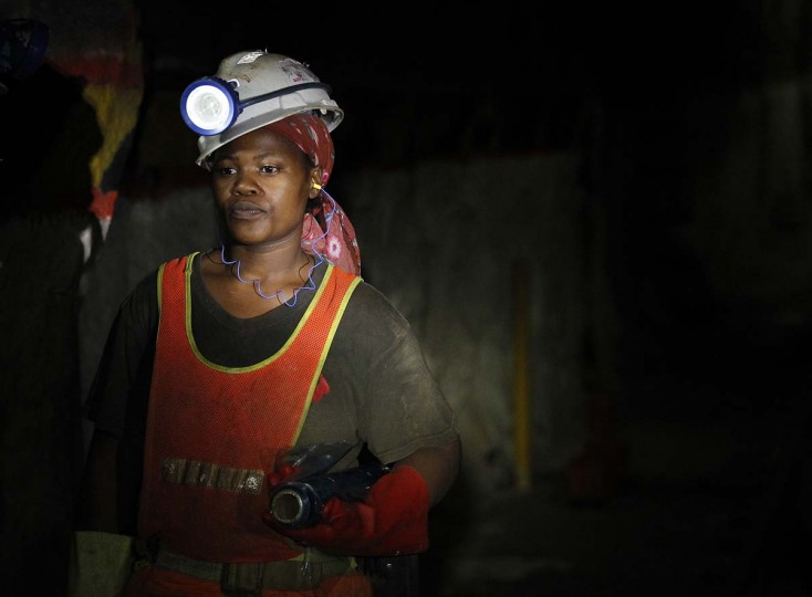 A female mine worker is seen underground at Lonmin's Karee mine in Rustenburg, 62 miles northwest of Johannesburg, March 5, 2013. Thousands of miners remained on strike at two shafts in South Africa's Marikana platinum mine on Tuesday, operator Lonmin Plc said, revising an earlier statement that they had gone back to work. (Siphiwe Sibeko/Reuters)