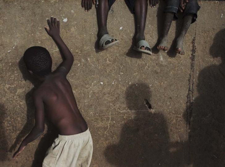 Boys play on a wall in Gao, Mali, March 5, 2013. (Joe Penney/Reuters)