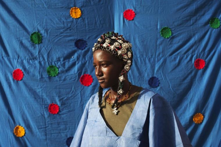Madinatou Soumailou Toure, 15, wears a traditional Songhai headdress made by artisan Hally Bara in Gao, Mali, March 6 2013. (Joe Penney/Reuters)