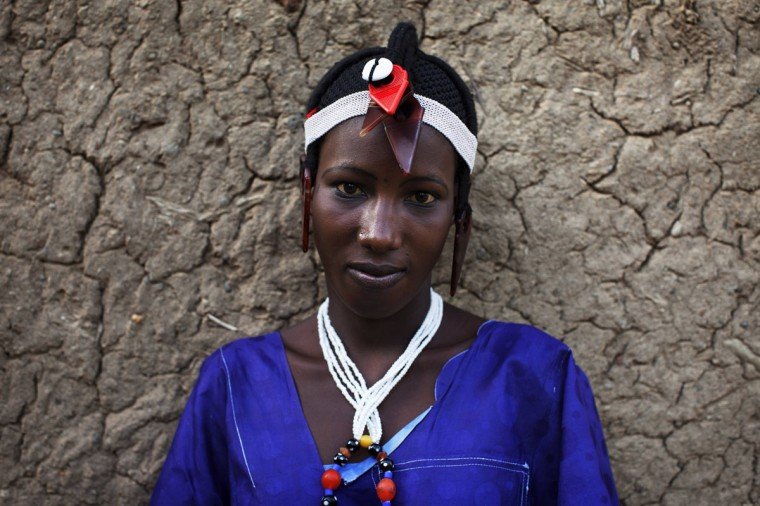 Fatoumata Toure, 15, wears a traditional Songhai headdress made by artisan Hally Bara in Gao, Mali, March 6, 2013. (Joe Penney/Reuters)